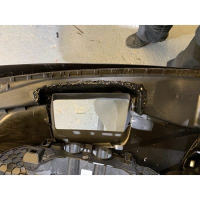 The underside of the dash with re-directed air ducting